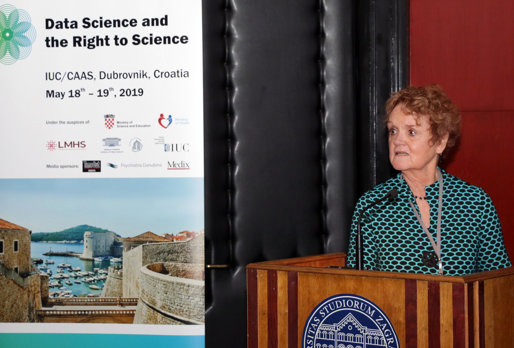 Val speaks from the podium at the Right to Science Conference in Dubrovnik